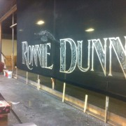 TRIO hand-painting the Ronnie Dunn backdrop