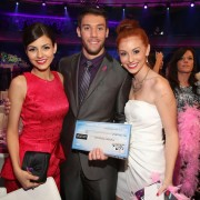 Halo award winner Matt Ferguson and his oversized TRIO printed check