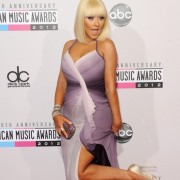 Christina Aguilera in front of TRIO printed step and repeat - 40th Annual AMAs
