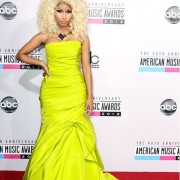 Niki Minaj in front of TRIO printed step and repeat - 40th Annual AMAs