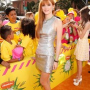 Bella Thorne in front of TRIO printed barricades at the Kid's Choice Awards 2013