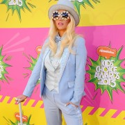 Ke$ha in front of TRIO printed step & repeat at the Kid's Choice Awards 2013