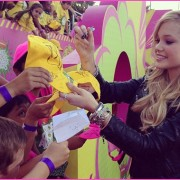 Olivia Holt signing autographs at the Kid's Choice Awards 2013 in front of TRIO prints