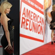 Mena Suvari at the American Reunion premiere in front of TRIO printed graphics