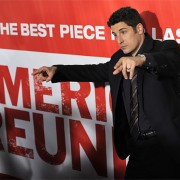 Jason Biggs at the American Reunion premiere in front of TRIO printed graphics