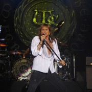 David Coverdale of Whitesnake in front of hand-painted backdrop