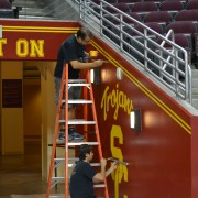 TRIO touching up paint in the USC Galen Center