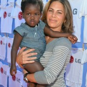 Jillian Michaels and Daughter in front of TRIO manufactured wall at LG event