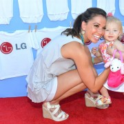 Melissa Rycroft & Ava in front of TRIO printed step & repeat at LG event