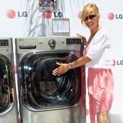 Sarah Brown in front of TRIO printed step & repeat for LG event