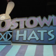 CNC routed Ostown Hats sign above hand-painted awning