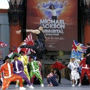 Dancers at the Michael Jackson Tribute in front of TRIO's print