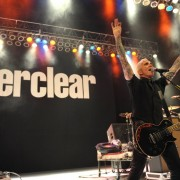 Art of Everclear in front of TRIO's hand-painted backdrop