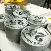 TRIO CNC-routed, printed graphics on 'Coin' props - 'Big Brother' Laundramat Challenge