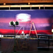 TRIO creating a hand-painted backdrop for a theatre in China