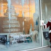 Santa lighting the holiday window display at Paley Media Center