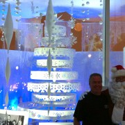 Santa and Ed Strang in front of the Paley Holiday window display