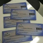 TRIO printed checks ready to present at the Halo Awards