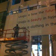 Late Night Installation of TRIO print at UNI QLO in New York