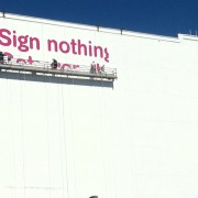 TRIO hand-painting the T Mobile ad along the 110 freeway in Los Angeles