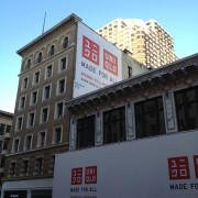 TRIO's grande-format printed and installed graphics at UNIQLO in San Francisco - construction barricade and billboard