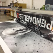 Seaming the Expendables 2 billboards in TRIOs facilities