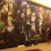 TRIO installing printed adhesive graphics at the USC Galen Center for League of Legends World Championship