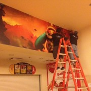 TRIO installing League of Legends graphics at the World Championship Competition