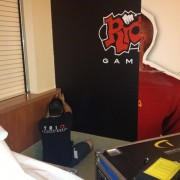 TRIO installing Riot games graphics at the USC Galen Center