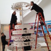 Installing the CNC routed Christmas tree in the Paley holiday window display