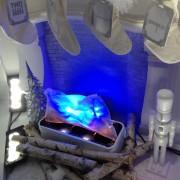 Faux fire in the sculpted foam fireplace