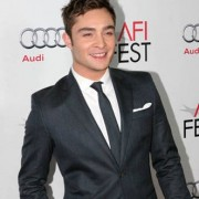 gossip girl's ed west wick in front of TRIO printed step & repeat at the J Edgar premiere