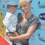 Jamie Pressly and son Dezi in front of TRIO printed step & repeat
