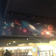 TRIO hand-painted space scene on the walls of the Cerritos Library