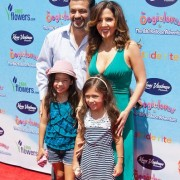 Maria Canals-Barrera and family at the Oogieloves Premiere in front of TRIO printed step & repeat (Photo By: Samuel Mora / PR Photos)