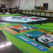 TRIO grande-format printed Green Day Scrim being finished in print shop