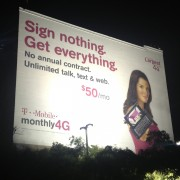 TRIO hand-painted T Mobile ad in Los Angeles lit up at night