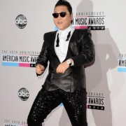 Psy in front of TRIO printed step and repeat - 40th Annual AMAs