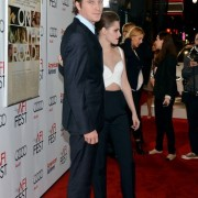 Garrett Hudland and Kristen Stewart in front of TRIO printed step and repeat at 'On the Road' premiere