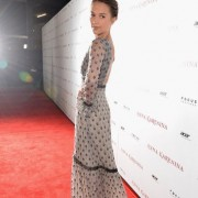 Alicia Vikander in front of TRIO printed step and repeat at Anna Karenina premiere in Hollywood
