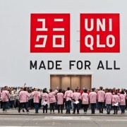 UNIQLO on Opening Day! TRIO's grande-format printed and installed graphics at UNIQLO in New York - construction barricade