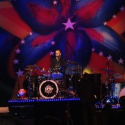 TRIO hand-painted backdrop on stage with Ringo Starr