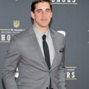TRIO's printed step and repeat behind quarterback Aaron Rodgers
