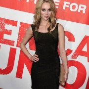 Autumn Fial at the American Reunion premiere in front of TRIO printed graphics